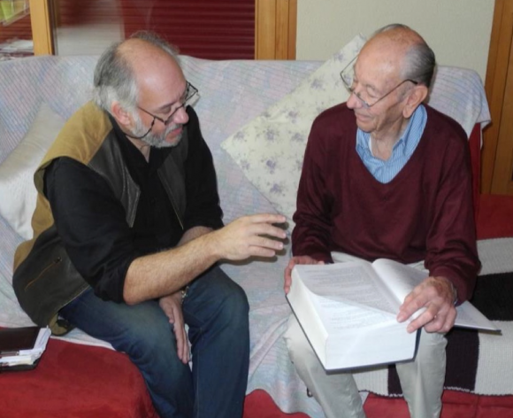 EWA Secretariat's Andy Gosler discusses the EWA project with Michel Desfayes (Volume 1 of the Thesaurus on his lap), Dec 2014. Photo: Stefano Doglio